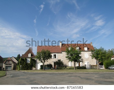 Medieval stone building   with blue sky in Meyronne, France
