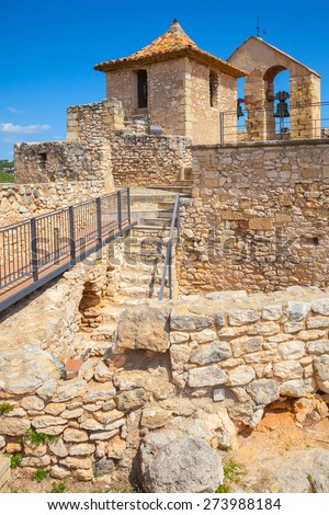 Medieval stone castle in ancient Calafell town, Spain, vertical photo - stock photo