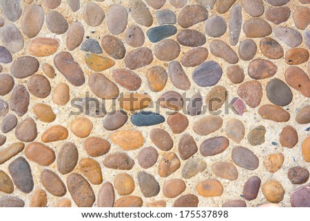 medieval stone wall background or texture with colorful pebbles