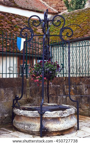 Medieval stone well in Champagne, France