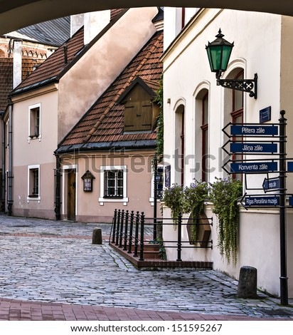 Medieval street in old town of Riga city, Latvia. In 2014, Riga is the European capital of culture