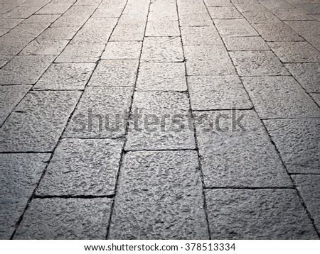 Medieval street paved with the cobble stone - stock photo