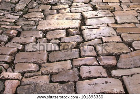 Medieval street paved with the cobble stones (Rovinj, Croatia, Europe) - stock photo
