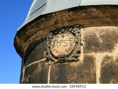 Medieval sundial on the tower, style  is missing - stock photo