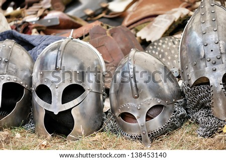 Medieval Templar helmets waiting for their knights  - stock photo