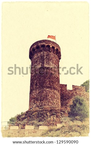 Medieval tower of an old fortress in the Spain. Vintage style photo. - stock photo