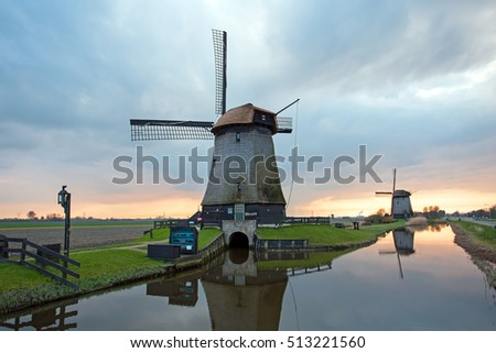 Medieval windmills in the countryside from the Netherlands at twilight