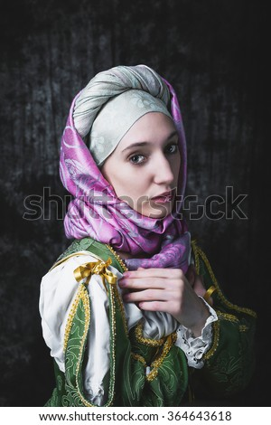Medieval woman holding hands in prayer . Pray. In the old beautiful yellow-green dress. Historic image. Gothic. Europe