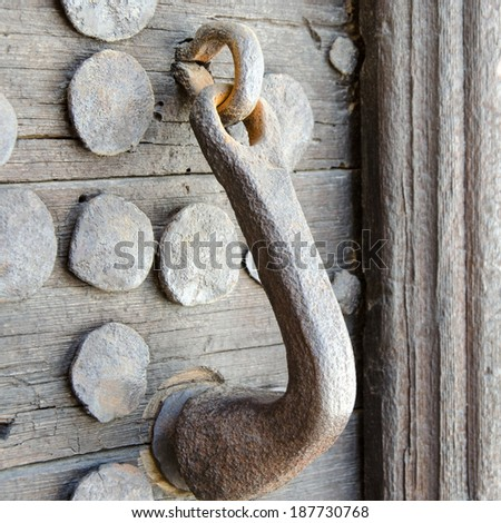 Medieval wooden door handle and bolts - stock photo