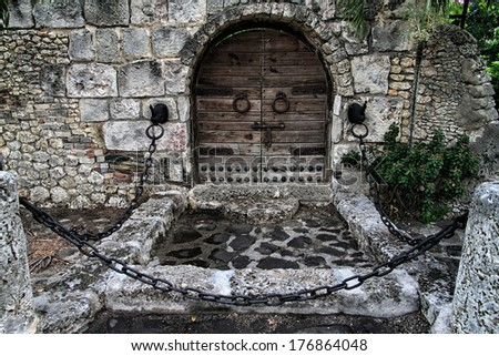 Medieval wooden door in the touristic place of Casa de Campo, Dominican Republic.