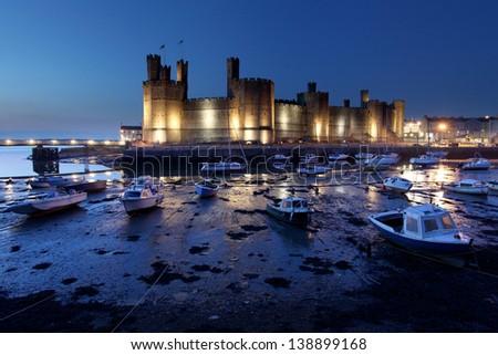 Medievil Caernarfon castle at twilight in north Wales - stock photo