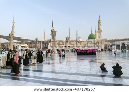 MEDINA, KINGDOM OF SAUDI ARABIA (KSA) - JAN 30: Pilgrims pray outside Masjid Nabawi after morning prayer Jan 30, 2015 in Medina, KSA. Underneath the green dome where Prophet Muhammad is laid to rest.
