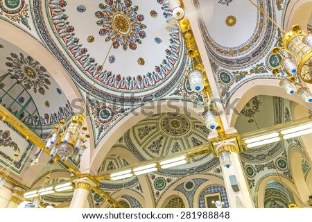 MEDINA-MAR 8 : Interior of Masjid Nabawi March 8, 2015 in Medina, Saudi Arabia. Nabawi Mosque is the second holiest mosque in Islam and here is Prophet Muhammad is laid to rest - stock photo