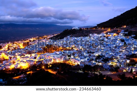 Medina of Chefchaouen view at twilight, Morocco. Chefchaouen is a city in northwest Morocco. It is the chief town of the province of the same name, and is noted for its buildings in shades of blue. - stock photo
