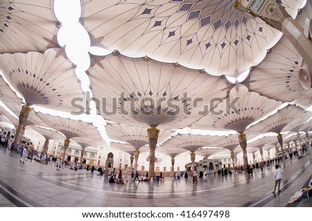 MEDINA, SAUDI ARABIA-CIRCA MAY 2015: beautiful fish eye view of underneath giant canopies in Nabawi Mosque on MAY, 2015 in Medina, Saudi Arabia .The Nabawi mosque is the second holiest mosque in Islam - stock photo