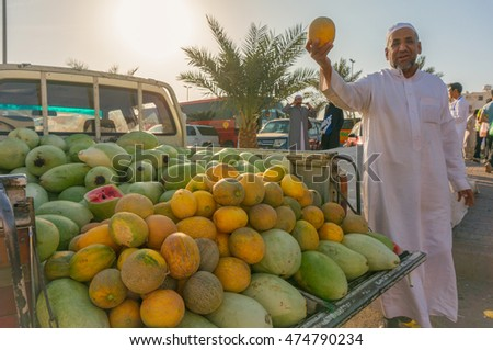 MEDINA, SAUDI ARABIA-DECEMBER 19, 2014: Unidentified man sells local produce in front of entrance of a Mosque in Medina Estimated that 10% of its population are employed.
