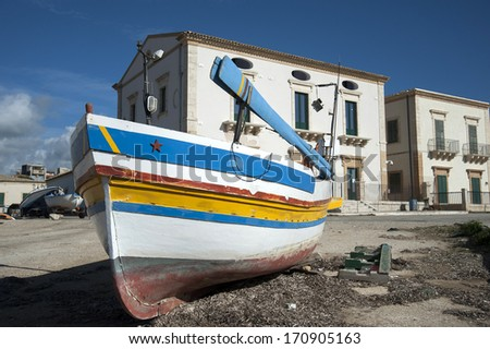 meditarranean harbour landscape with fisherboat, donnalucata, sicily, italy
