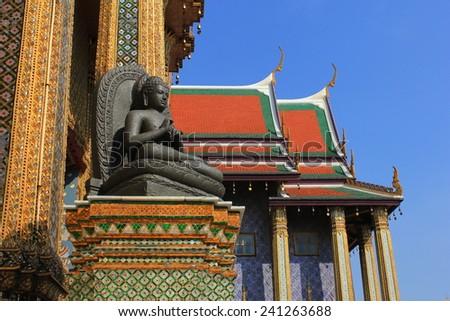 Meditating Buddha Statue at temple of the emerald buddha in Bangkok - stock photo