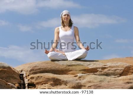Meditating on a rock - stock photo