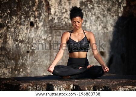 Meditating on the rock - stock photo