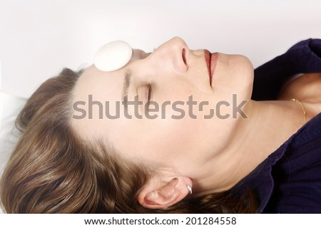 Meditating woman with focus on third eye