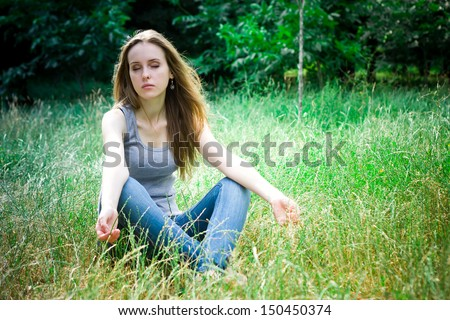meditation of young pretty woman in a forest