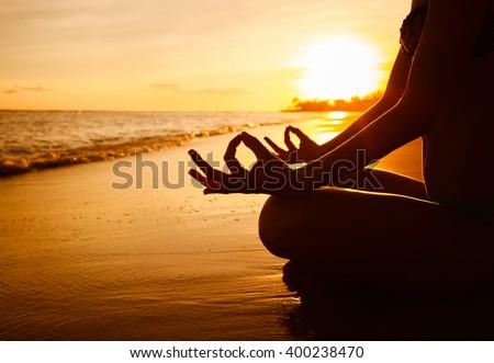 Meditation on the beach. - stock photo