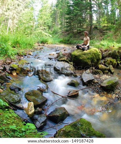 Meditation on the river - stock photo