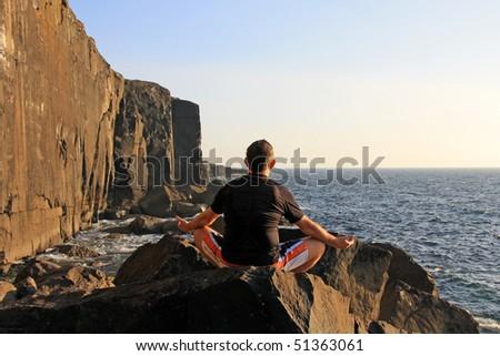 Meditation on the rock - stock photo