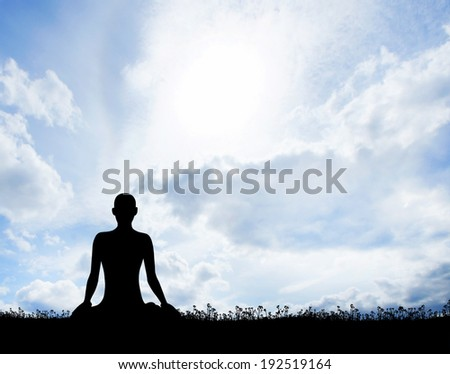 Meditation. Silhouette of a woman doing yoga exercises. - stock photo
