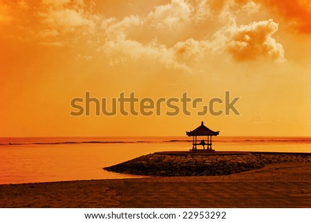 Meditation under sky of Asia. Photographed on beach Sanur. Bali island. Indonesia. - stock photo