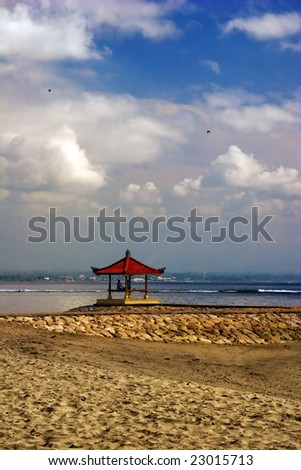 Meditation under sky of Asia. Photographed on beach Sanur. Bali island. Indonesia.