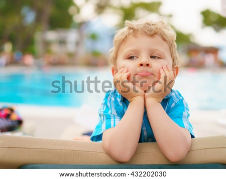 Meditative time of a kid sitting on resort couch