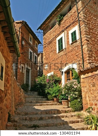 mediterranean ancient houses and narrow alleyway at fornalutx, old spanish village, majorca - stock photo