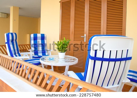 Mediterranean apartment terrace exterior with chairs. - stock photo