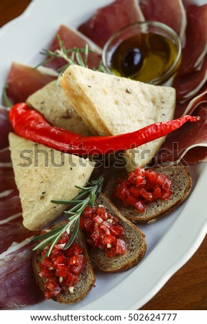 Mediterranean appetizer with prosciutto and cheese