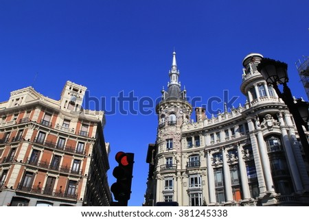 Mediterranean architecture in Madrid, Spain. Old apartment building  on Street known as Gran Via, one of the busiest streets of the city