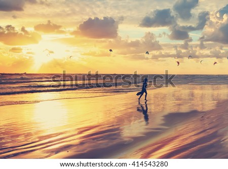 Mediterranean beach gold sunset view and kite surfing. Toned colors vintage photo