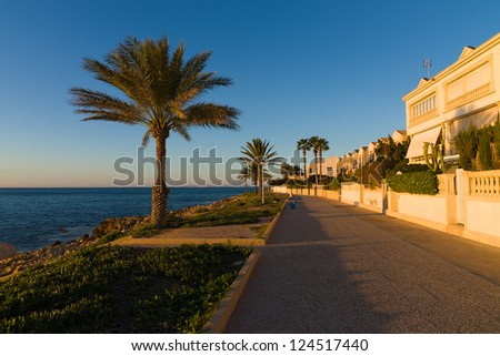 Mediterranean beach promenade, Santa Pola on Costa Blanca at early morning sunlight