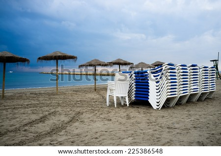 Mediterranean beach with an overcast  stormy sky - stock photo