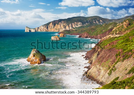 Mediterranean coast with high cliffs and rough sea - horizontal version