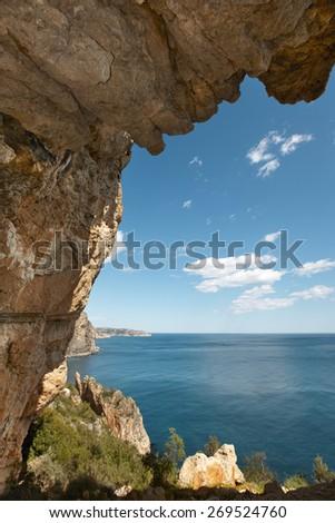 Mediterranean coastline landscape with cave in Alicante. Spain. Vertical - stock photo