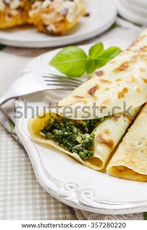 Mediterranean cuisine: crepes stuffed with cheese and spinach