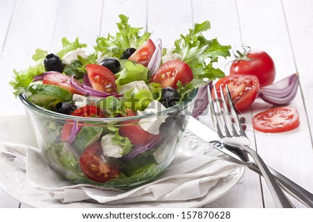 Mediterranean Greek Salad with Feta on white - stock photo