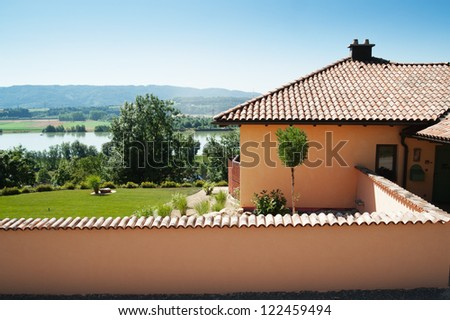 Mediterranean House with Wall - stock photo