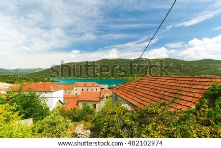 Mediterranean houses with red roofs and Adriatic Sea in the background, Dalmatia, Croatia, Europe