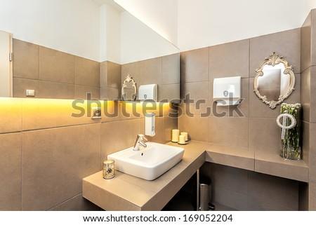 Mediterranean interior - a modern restroom with a big mirror - stock photo