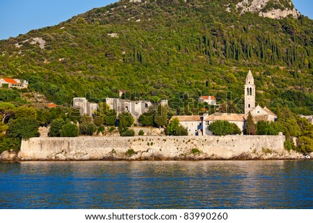 Mediterranean landscape. Island Lopud near Dubrovnik, Croatia. Old monastery with bell tower - stock photo