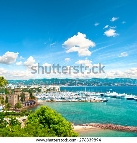 Mediterranean landscape with cloudy blue sky. View of sea and luxury resort of Cote d'Azur in France. French riviera - stock photo