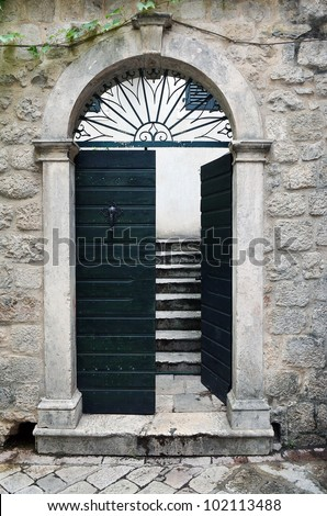 Mediterranean old door with knocker - stock photo